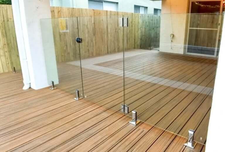frameless glass pool fence gate on wooden deck