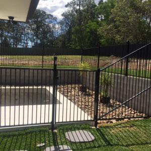 Custom black flat top pool panel fence