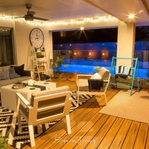outdoor area at night with a frameless glass pool fence