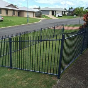 Raked Fencing in front yard